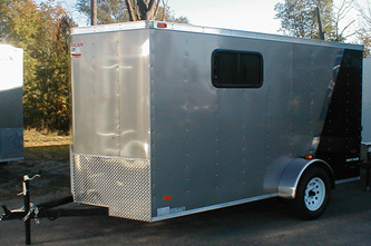 Pewter and black enclosed utility trailer with transition strip