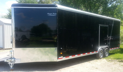 Exterior view of dual axle car hauler in black with stone guard and screwless exterior.
