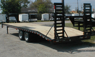 Open dual axle utility trailer with standup ramps and wooden deck