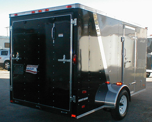 Enclosed black and bronze American Hauler utility trailer with transition strip