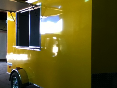 Haulmark Transport Concession/Vending trailer in yellow, screwless exterior.