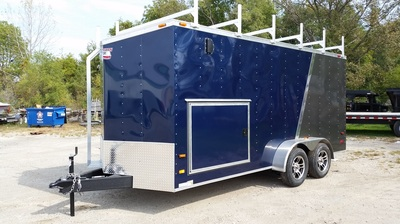 American Hauler dual axle enclosed utilty trailer in blue and pewter with transition strip, stoneguard and racks on roof, side access door