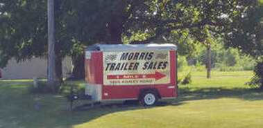 Morris Trailer Sales Inc Red Sign Trailer at Route 6 and Ashley Road