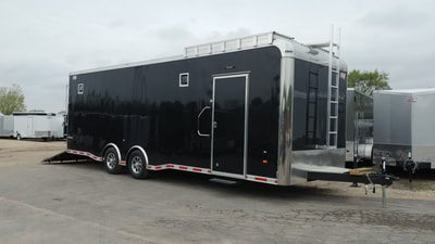 Bonnie's one of a kind race track special dual axle enclosed trailer with rooftop platform, exterior halogen lamps and many other special features, including extra handle for easier entry at side door