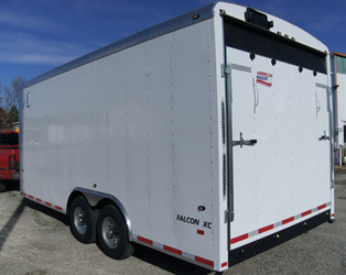 American Hauler enclosed dual axle utility trailer with rear ramp door in white