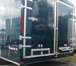 Falcon XC enclosed utility trailer with double rear doors in dark green