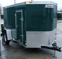 Enclosed Haulmark utility trailer with stoneguard and side door