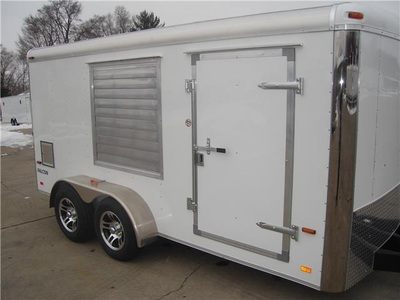 Exterior shot of dual axle vending/concession trailer showing rollup window and side door with loading lights
