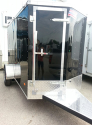 Front view of black single axle enclosed utilty trailer with front door on the V Nose and stoneguard