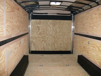 Interior of Enclosed utility trailer with plywood floor, walls, rear ramp and roof vents