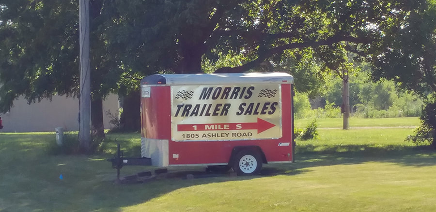 Trailer With Sign for Morris Trailer Sales, Inc., located at Route 6 and Ashley Road.